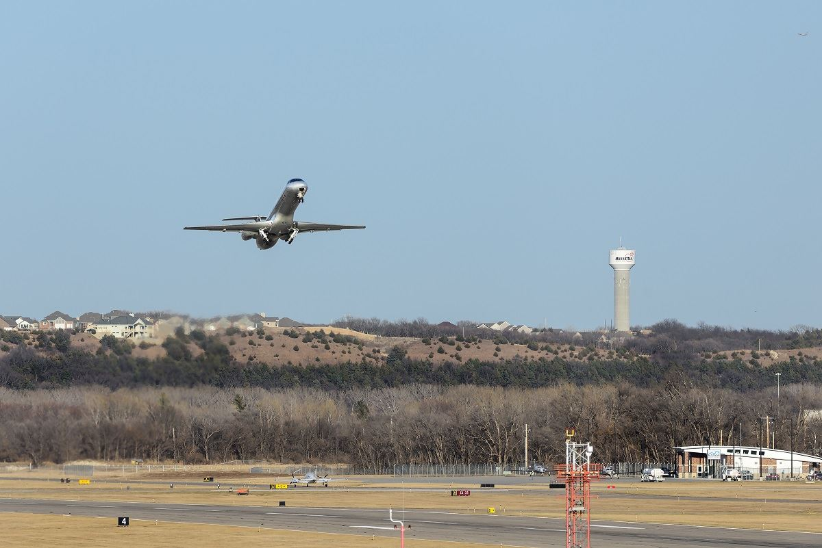 photo of plane taking off from Manhattan Regional Airport
